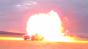 Car Driving Through Flame Burst Image